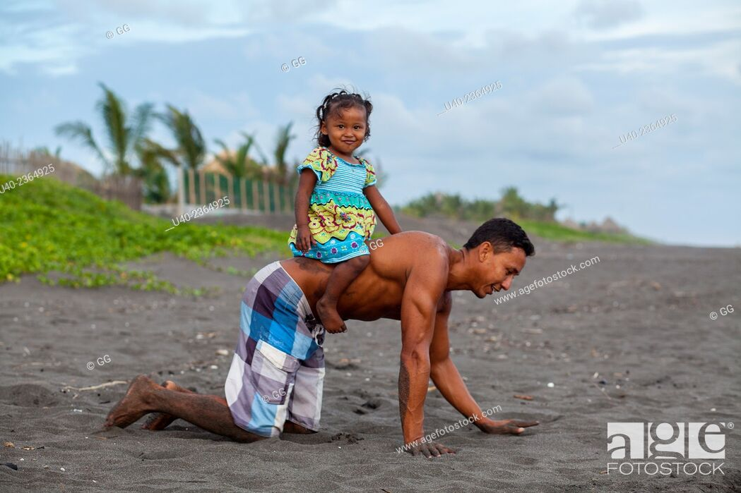 Stock Photo: Guatemala, El Paredon, father playing with daughter.