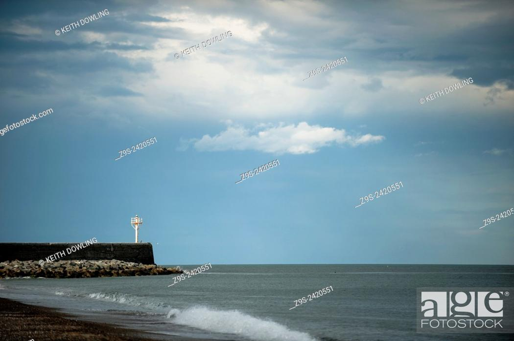 Stock Photo: Small Harbour Pier, and lighthouse at Arklow bay. County Wicklow, Ireland. Calm winter day with soft light.