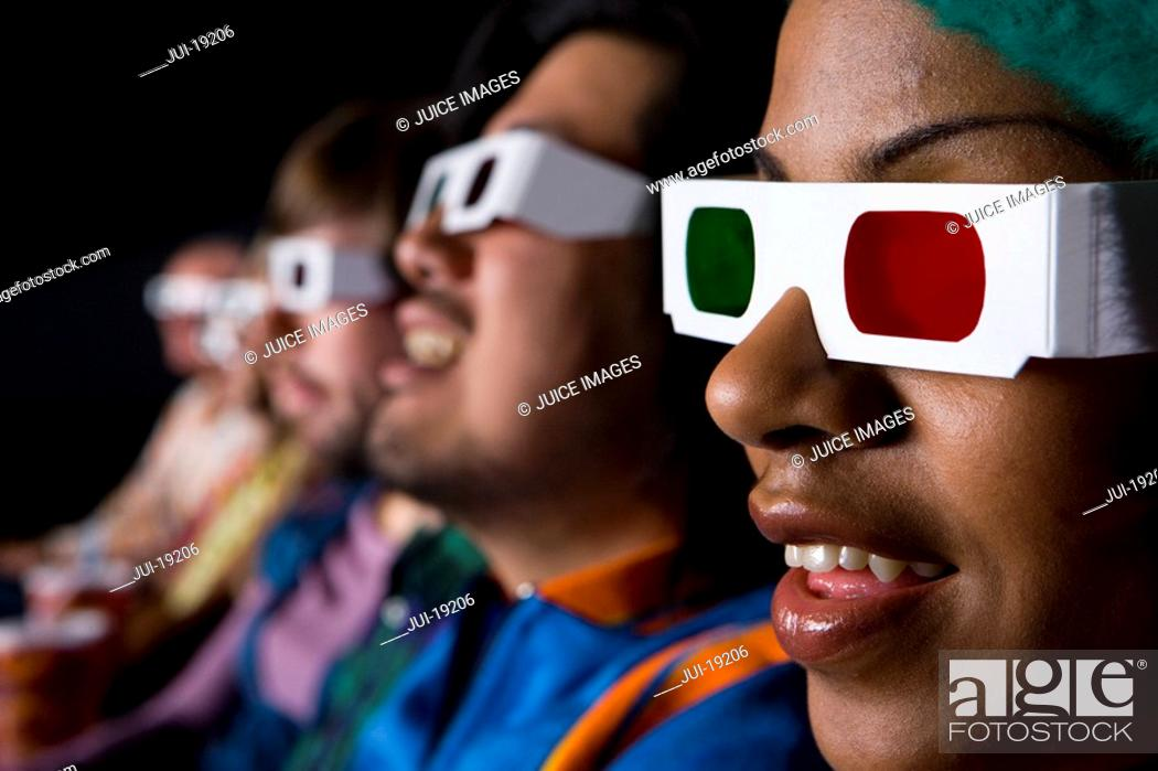 Stock Photo: Audience in cinema wearing 3D glasses, close-up.