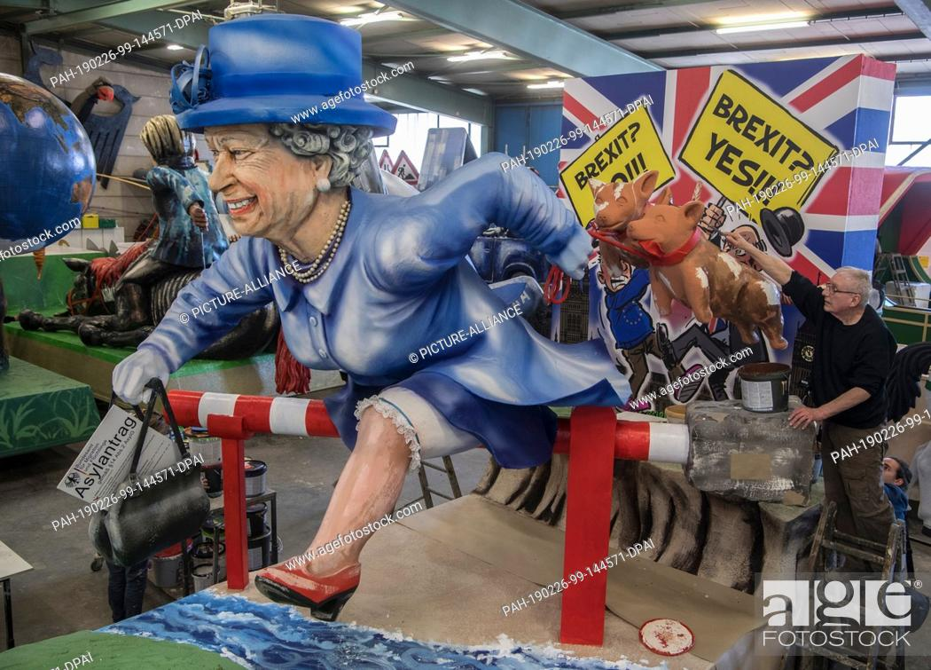 Stock Photo: 26 February 2019, Rhineland-Palatinate, Mainz: With an asylum application in her hand, the Queen jumps across the barrier into the EU during the presentation of.
