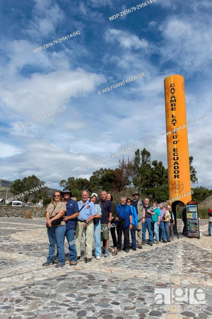 Stock Photo: A tour group is standing with one foot in the northern hemisphere and the other foot in the southern hemisphere at the Quitsato equator monument and sundial.