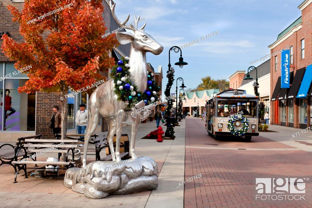 Stock Photo: Silver deer statues decorated for Christmas at the Branson Landing shopping center in Branson, Missouri, USA,.