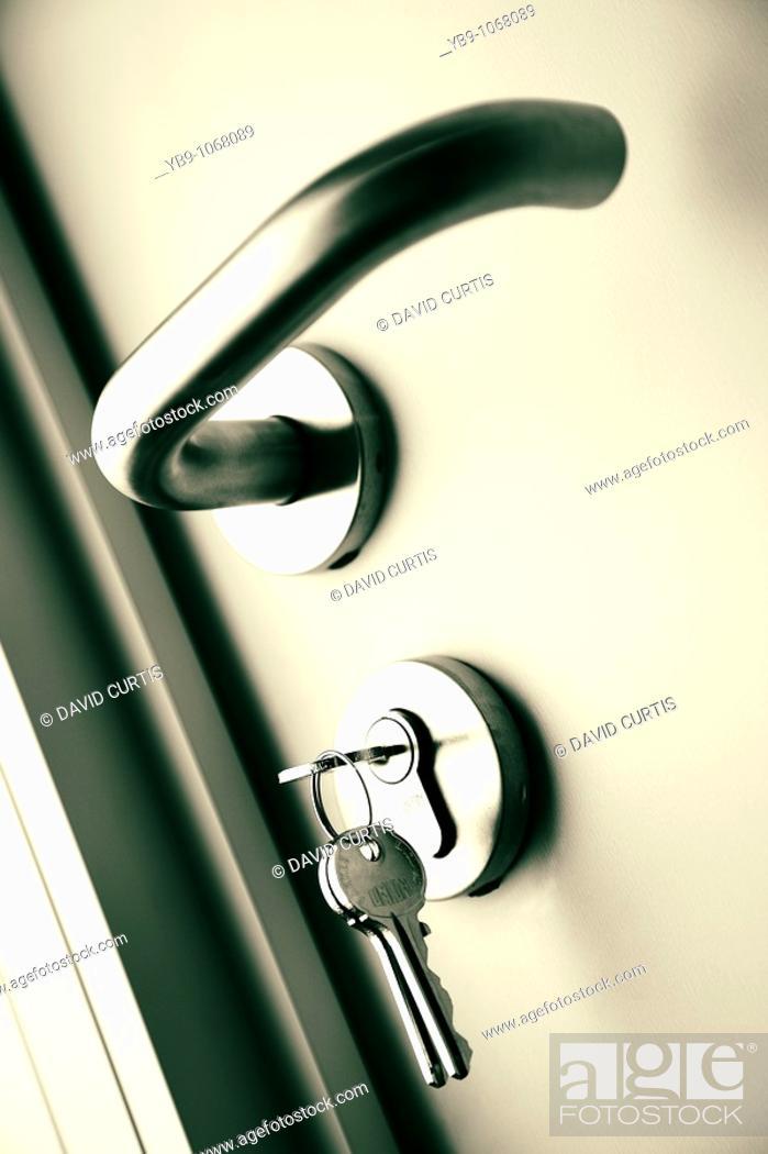 Stock Photo: Door handle with keys in.
