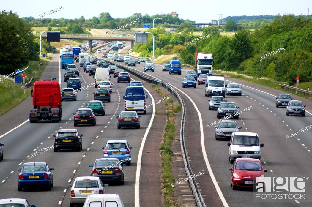 Stock Photo: lines of busy traffic on the M40 betweem Birmingham and London.