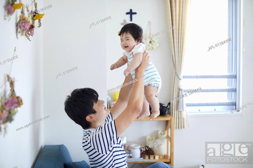 Stock Photo: Japanese family at home.