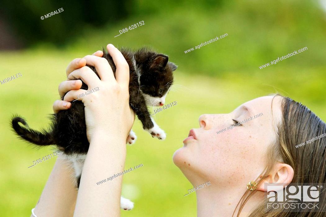 Stock Photo: Girl and kitten.