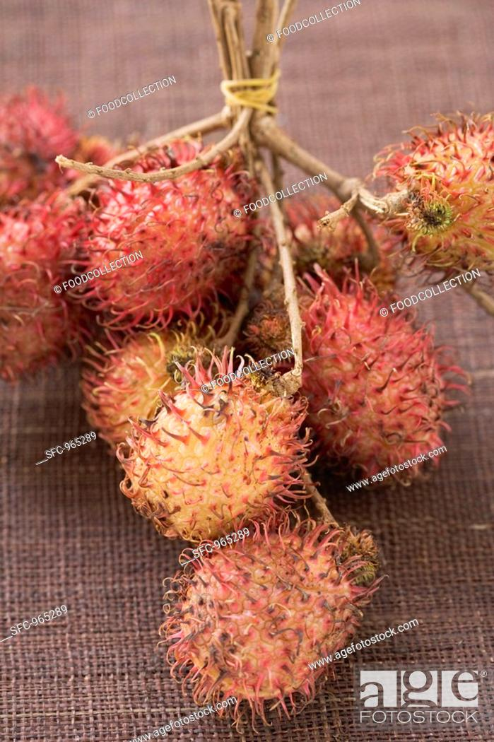 Stock Photo: Rambutans on stalks.