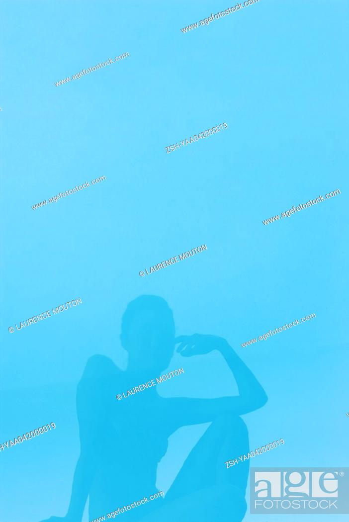 Stock Photo: Young woman reflected in surface of water.