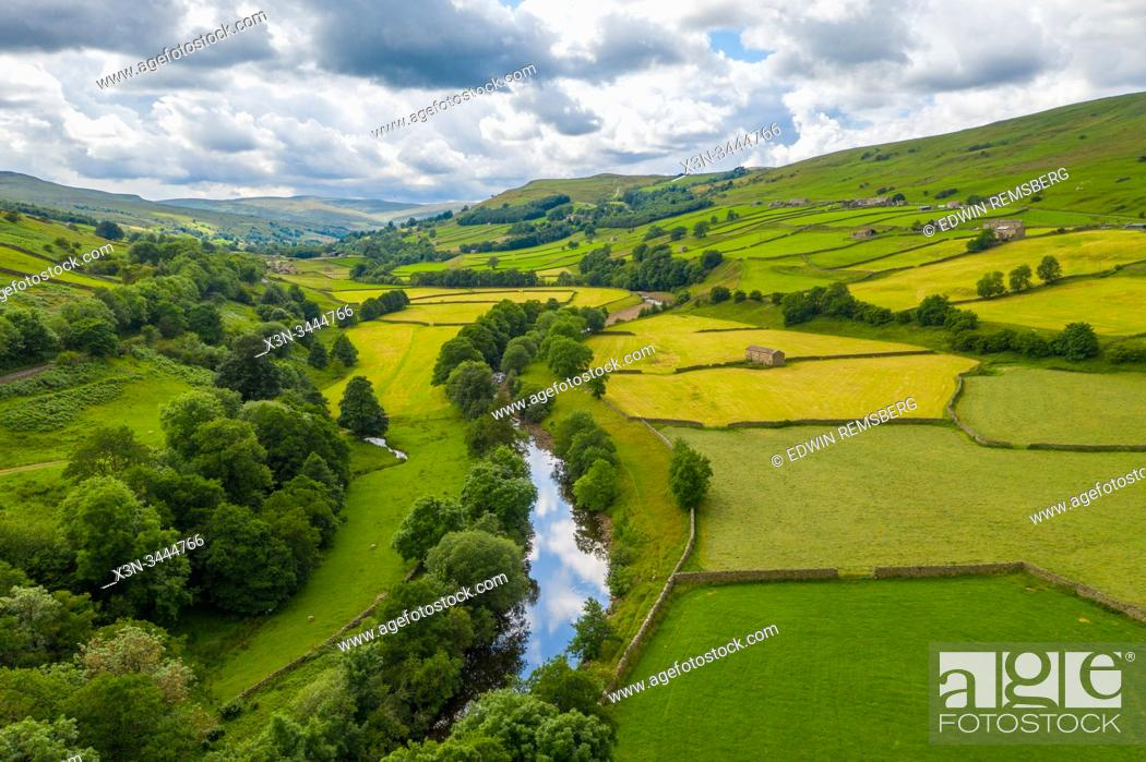 Stock Photo: The River Swale snakes through the countryside of Swaledale, Yorkshire, UK.