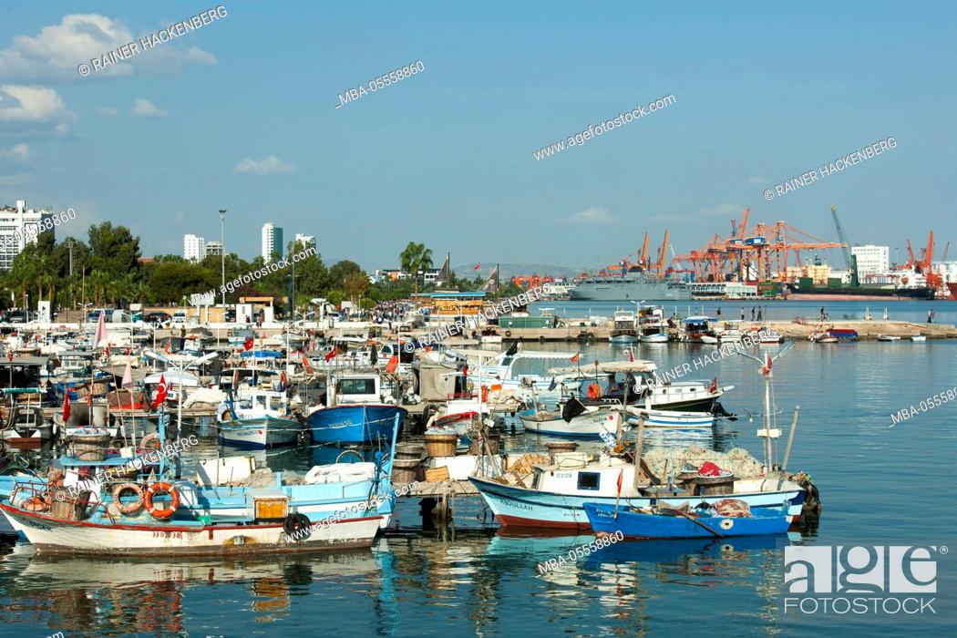 Stock Photo: Turkey, Mersin, fishing harbour, at the background the modern industrial harbour.