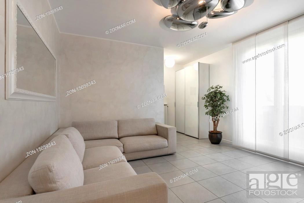 Stock Photo: Italian interior design. Stylish living room in white color with sofa.