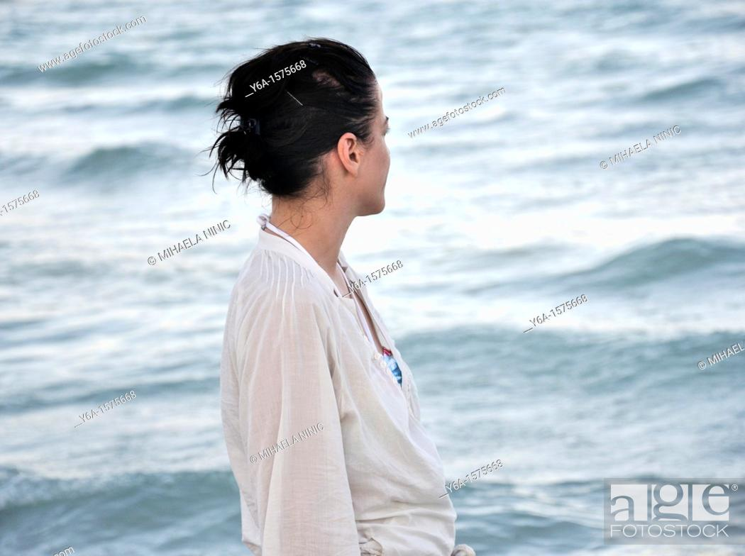 Stock Photo: Young woman looking out to sea.