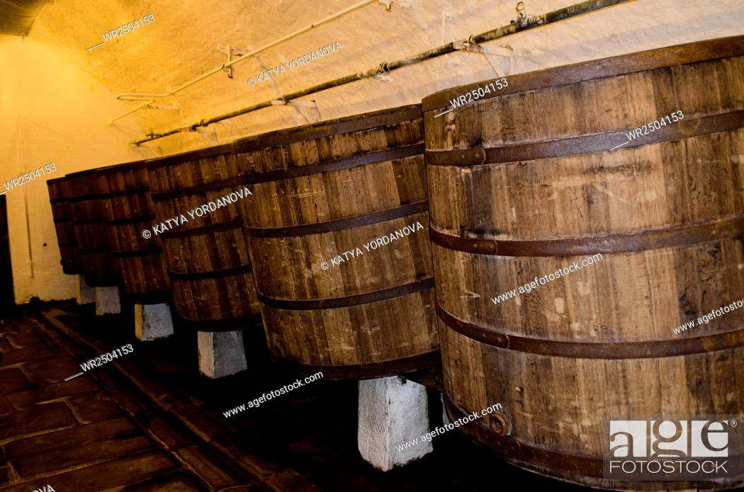Stock Photo: Old wooden barrels in cellars of Pilsner Urquell Brewery.