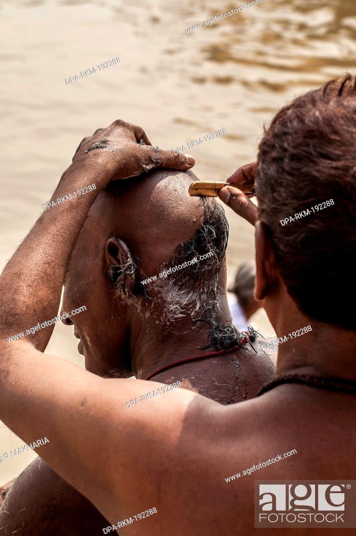 Stock Photo: Barber Shaving Head Ganga River Varanasi Ghat Uttar Pradesh India Asia.