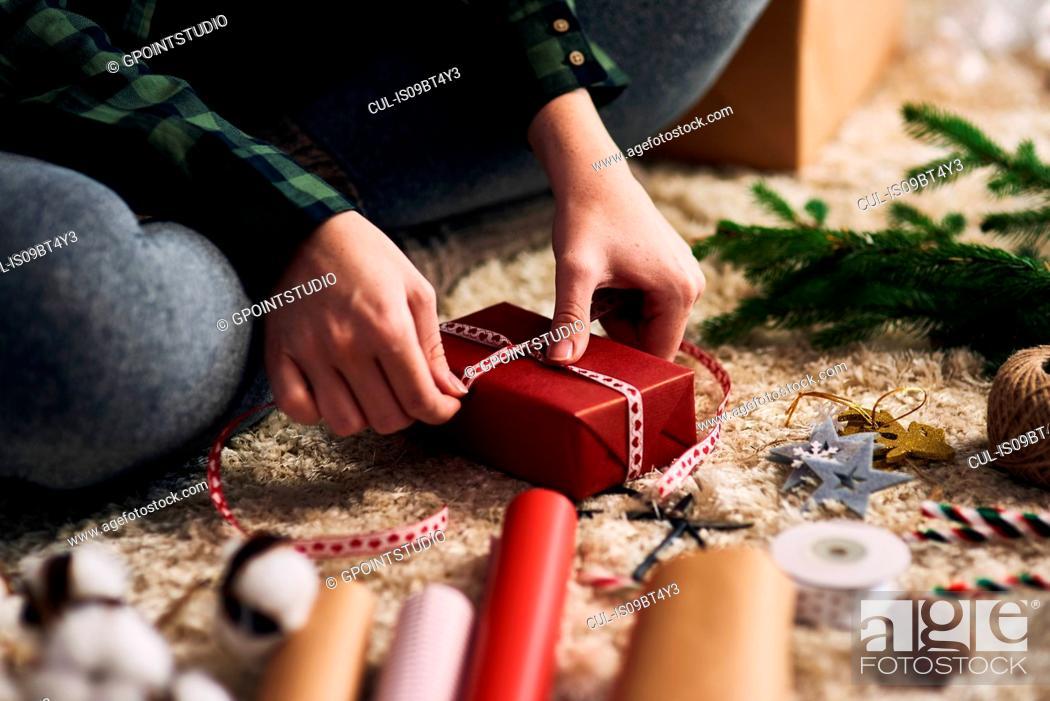 Stock Photo: Woman wrapping Christmas presents.