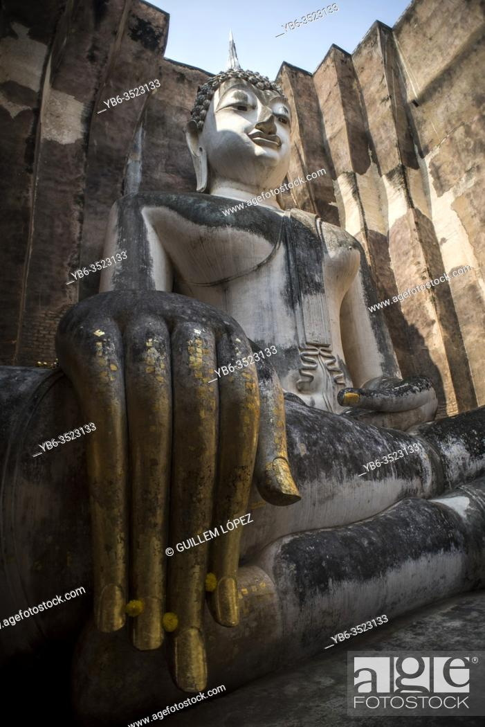 Stock Photo: Phra Achana Buddha statue at the Wat Si Chum temple, Sukhothai Historical Park, Sutkhothai, Thailand.