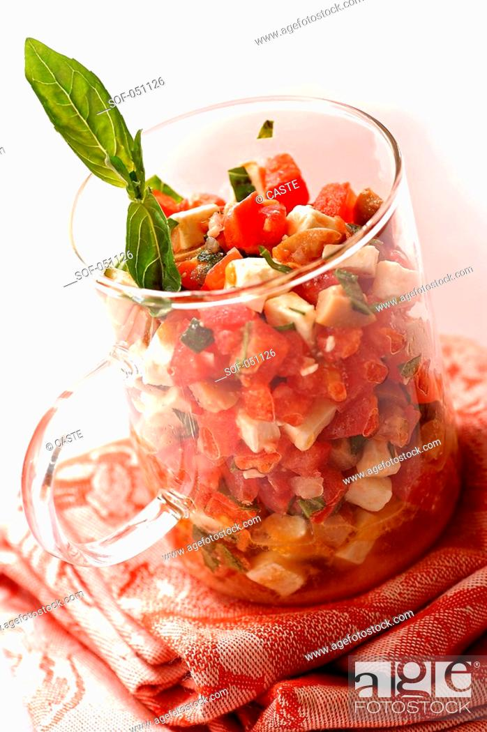 Stock Photo: tomato and goat's cheese tartare with olives and basil.