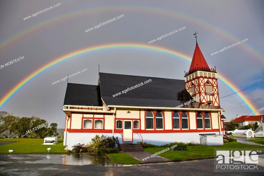 Stock Photo: Rainbows over Maori owned Church of St Faith, Ohinemutu, Rotorua.
