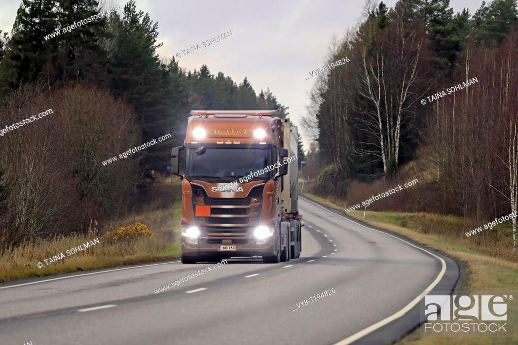 Stock Photo: Salo, Finland - November 16, 2018: Next Generation Scania S730 of Heikkila for chemical transport on the road in autumn with high beams on briefly. .