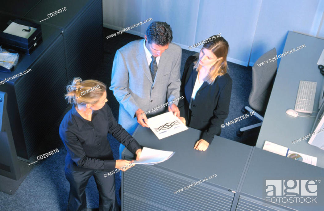 Stock Photo: Three businesspeople looking on files.