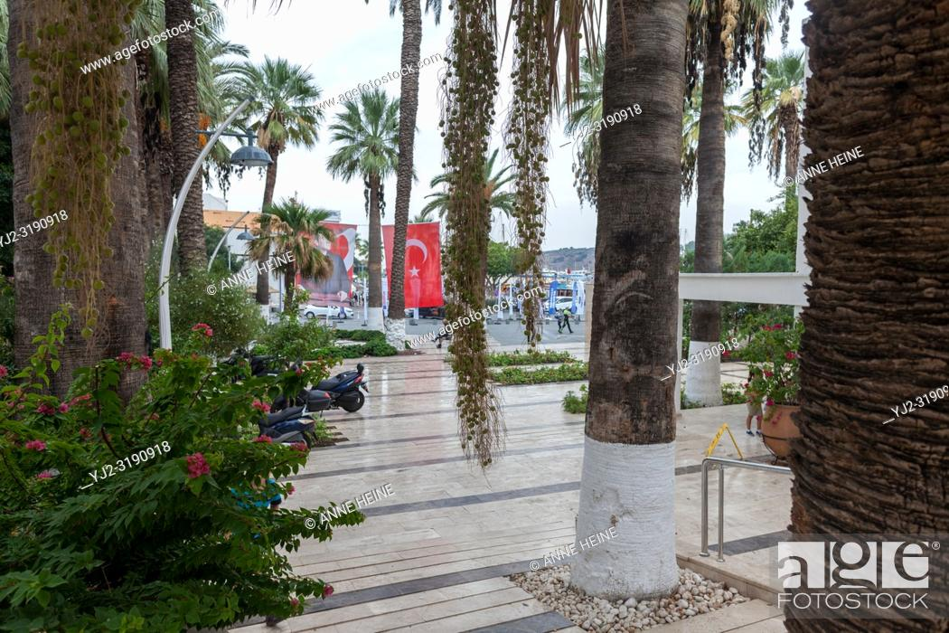Stock Photo: Looking from town-hall Bodrum towards entrance with palm trees, minaret and harbour. Bodrum, Turkey.