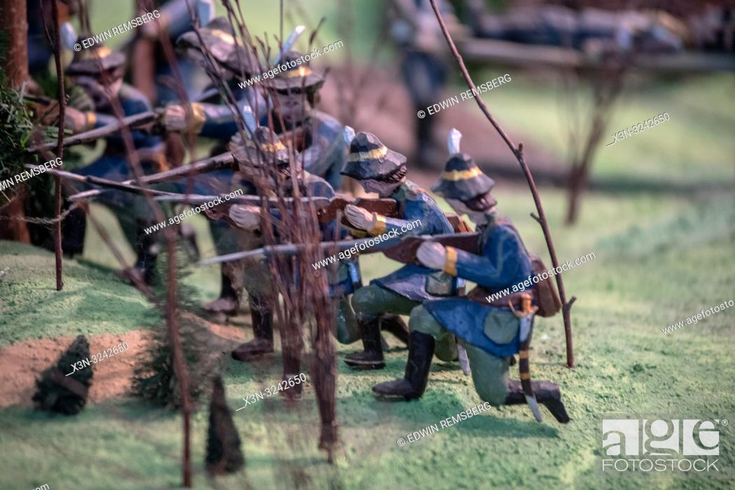 Wooden miniatures of Russian soldiers aiming muskets during the