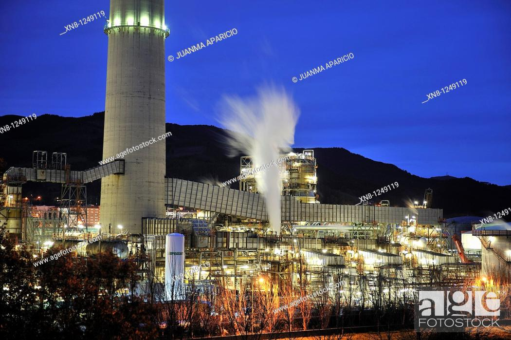 Stock Photo: Petronor refinery photographed at night with long exposure time in the town of Muskiz, Basque Country, Spain.