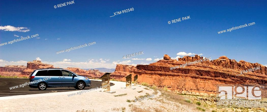 Stock Photo: Mini van stopped at viewing area overlooking Spotted Wolf Canyon / San Rafael Reef in the San Rafael Swell in the American Southwest.