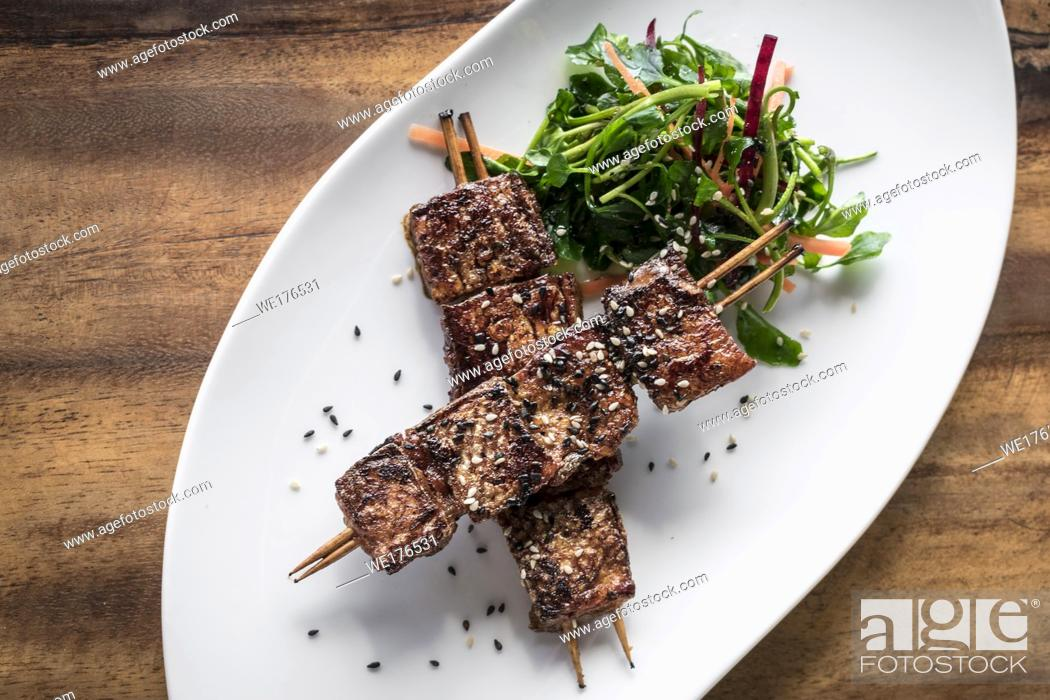 Stock Photo: asian spicy sweet soy sauce and sesame seed grilled barbecue pork skewers in singapore restaurant.