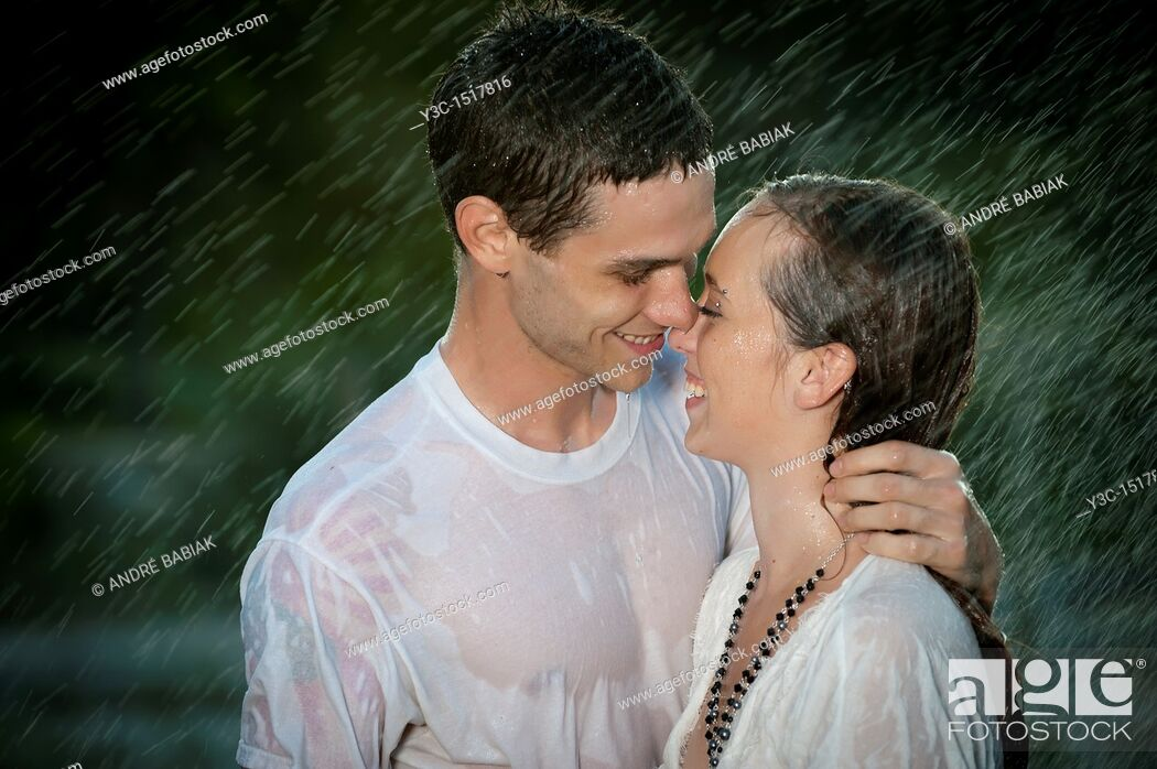 Stock Photo: Couple in love in the rain.
