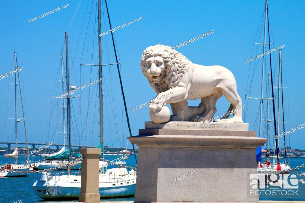 Stock Photo: The Bridge of Lions, St. Augustine Florida, is guarded on each side of the road by a sculpture of a marble Medici lion. This Medici Lion is on the south side of.