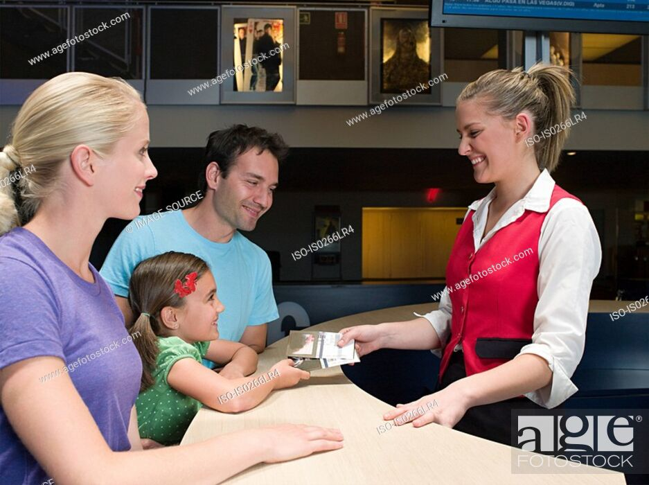 Stock Photo: A family buying tickets from the box office.