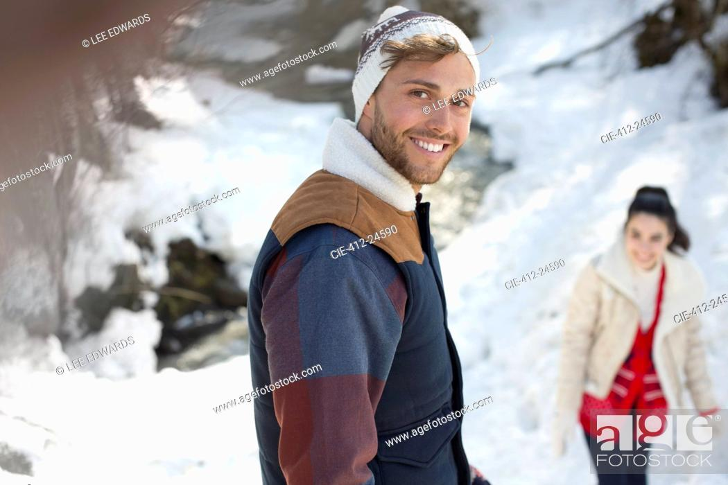 Stock Photo: Portrait of smiling couple in snow.