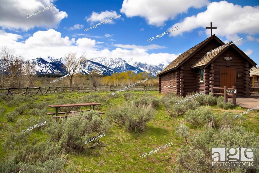 Stock Photo: USA, Wyoming, Jackson Hole. A tiny church perched beneath the Grand Tetons.