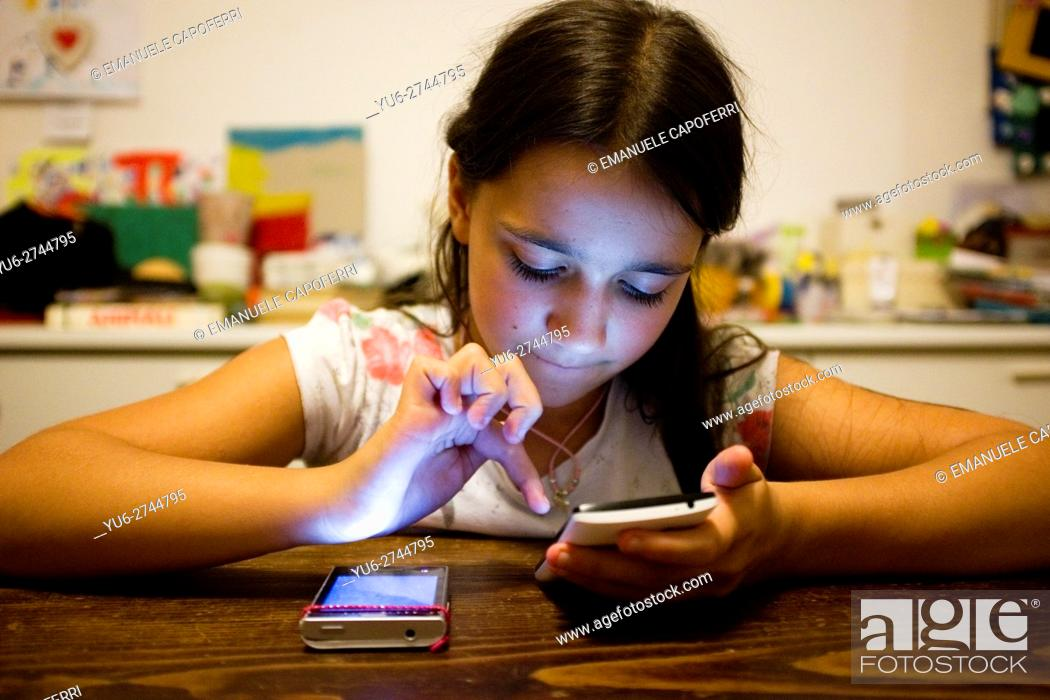 Stock Photo: 10 year old girl with smartphone.
