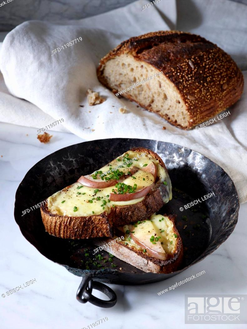 Stock Photo: Cheese and pear on toast with chives.