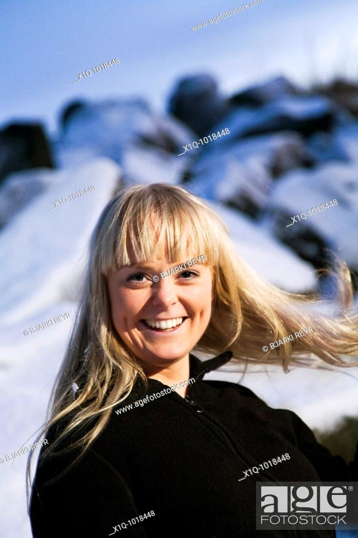 Stock Photo: Young woman laughing. Wintertime, Iceland.