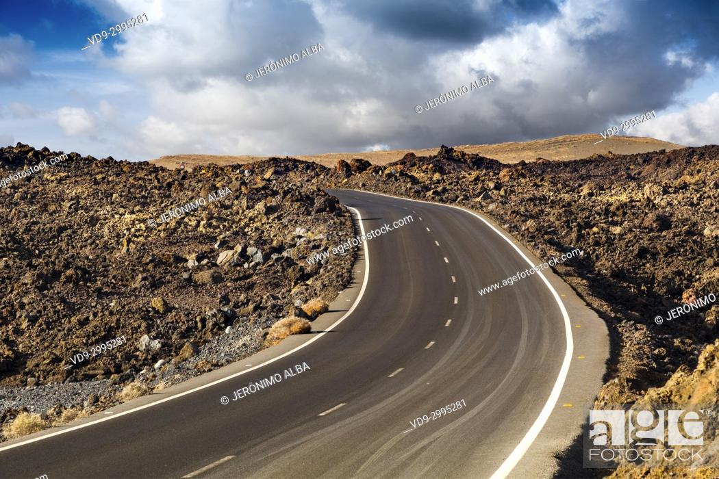 Stock Photo: Road through volcanic landscape. Lanzarote Island. Canary Islands Spain. Europe.