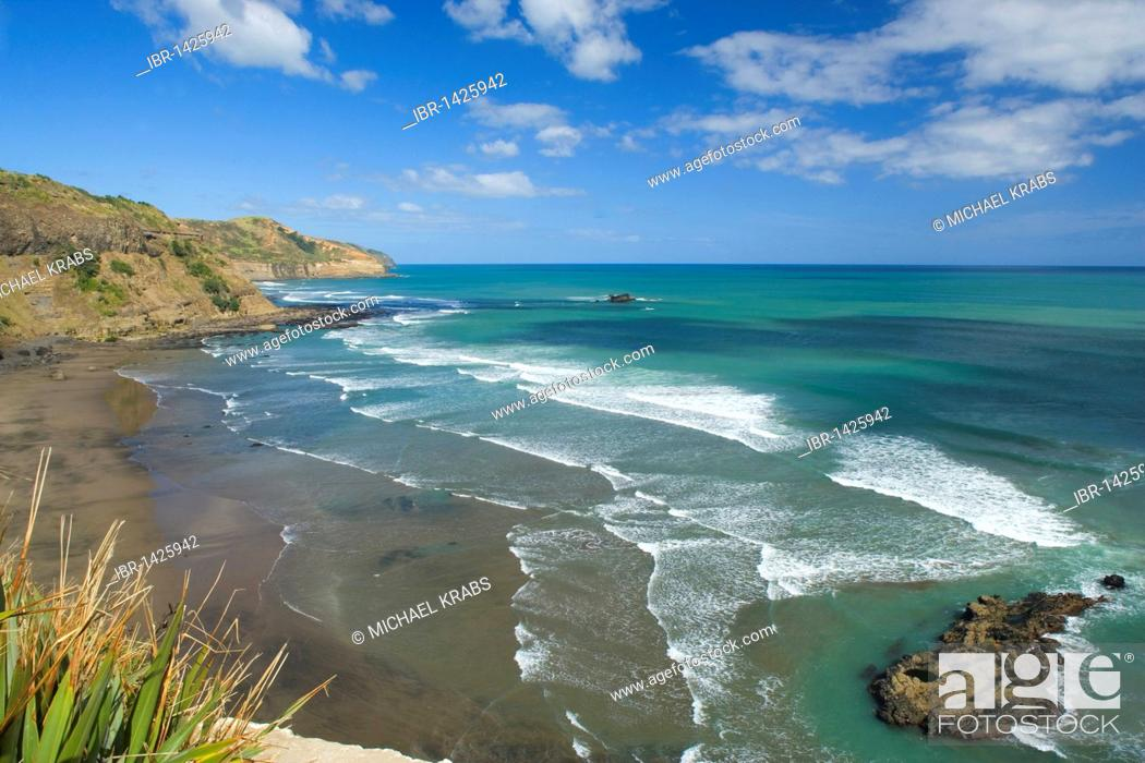 Stock Photo: Waves rolling on the black beach of Maori Bay, Muriwai Regional Park, Auckland, North Island, New Zealand.