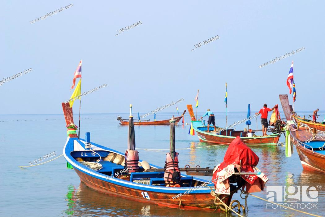 Stock Photo: Thai fishing boats at Kata Beach, Phuket.