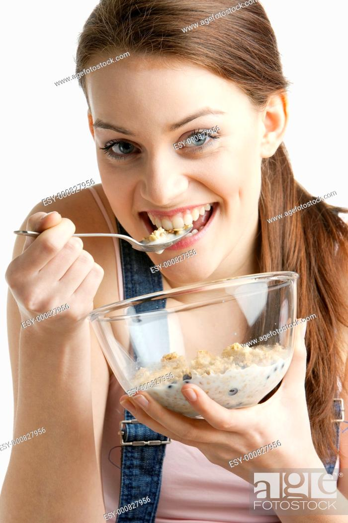 Stock Photo: portrait of woman eating cereals.