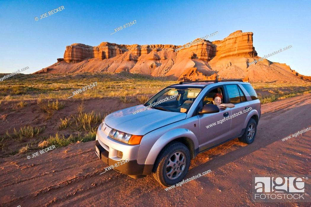 Stock Photo: Woman in a SUV on a dirt road in Utah.