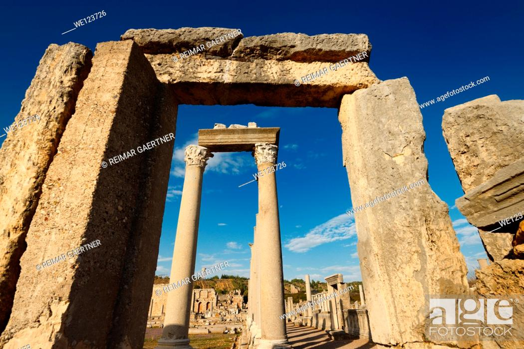 Stock Photo: Stone door frame to the corner columns of the Agora at the Perge ruins Turkey.