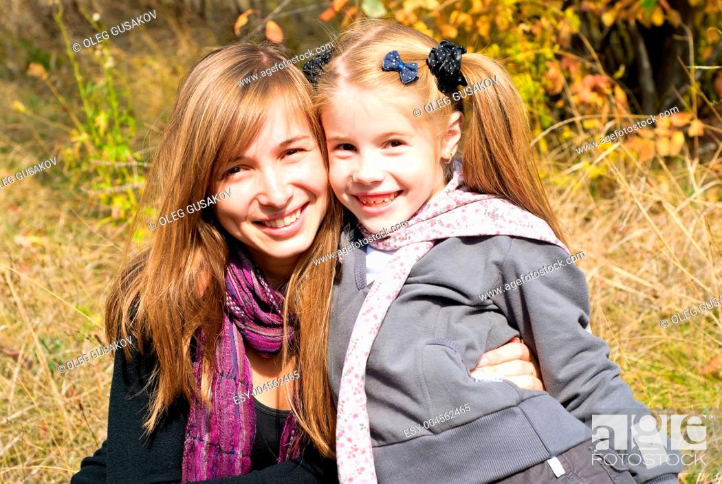 Stock Photo: Smiling young mother with little daughter.