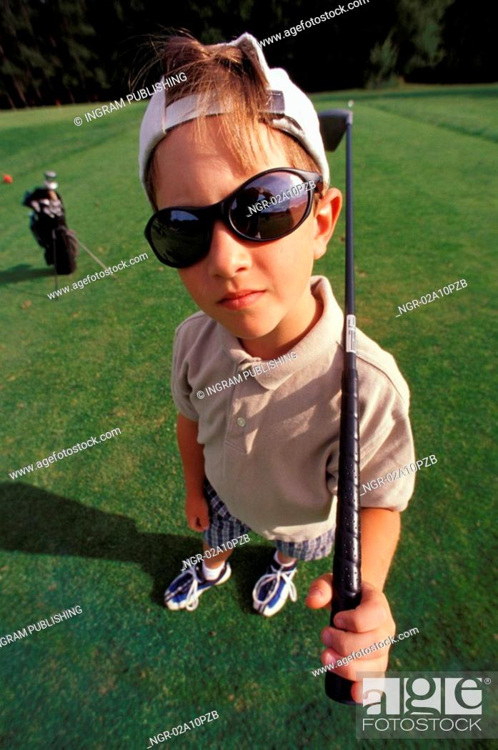 Stock Photo: little boy posing with a golf club.