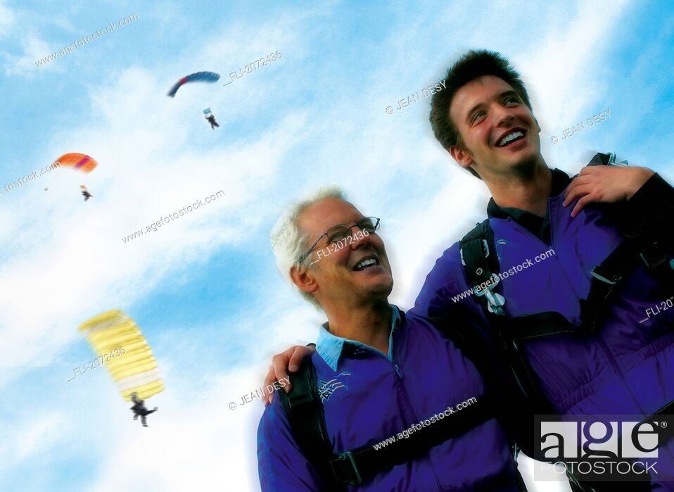 Imagen: Father And Son Smiling, Three Parachutists Flying In Sky Background.