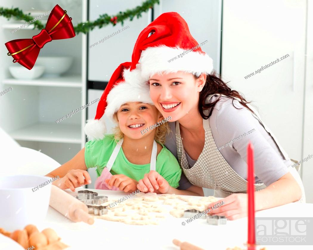 Stock Photo: Portrait of a cute girl with her mother baking christmas cookies.