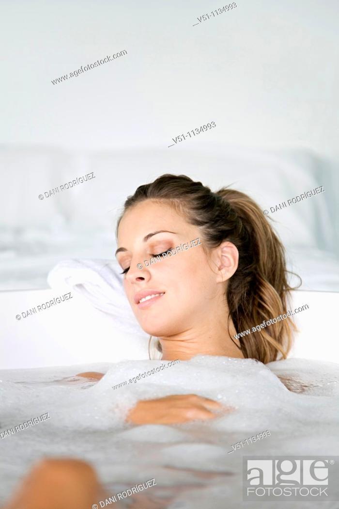 Stock Photo: Young blonde woman enjoying a bath.