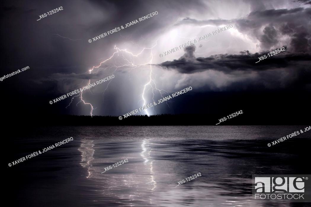 Stock Photo: Lightning in Illa de Buda, Natural Park of Delta de l'Ebre, Tarragona, Spain.