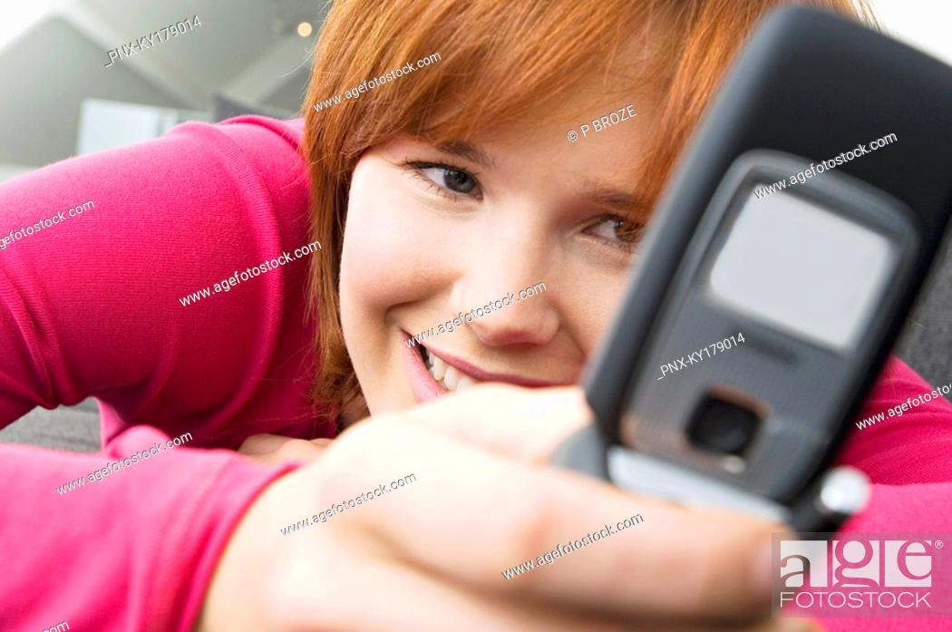Stock Photo: Close-up of a young woman using a mobile phone.